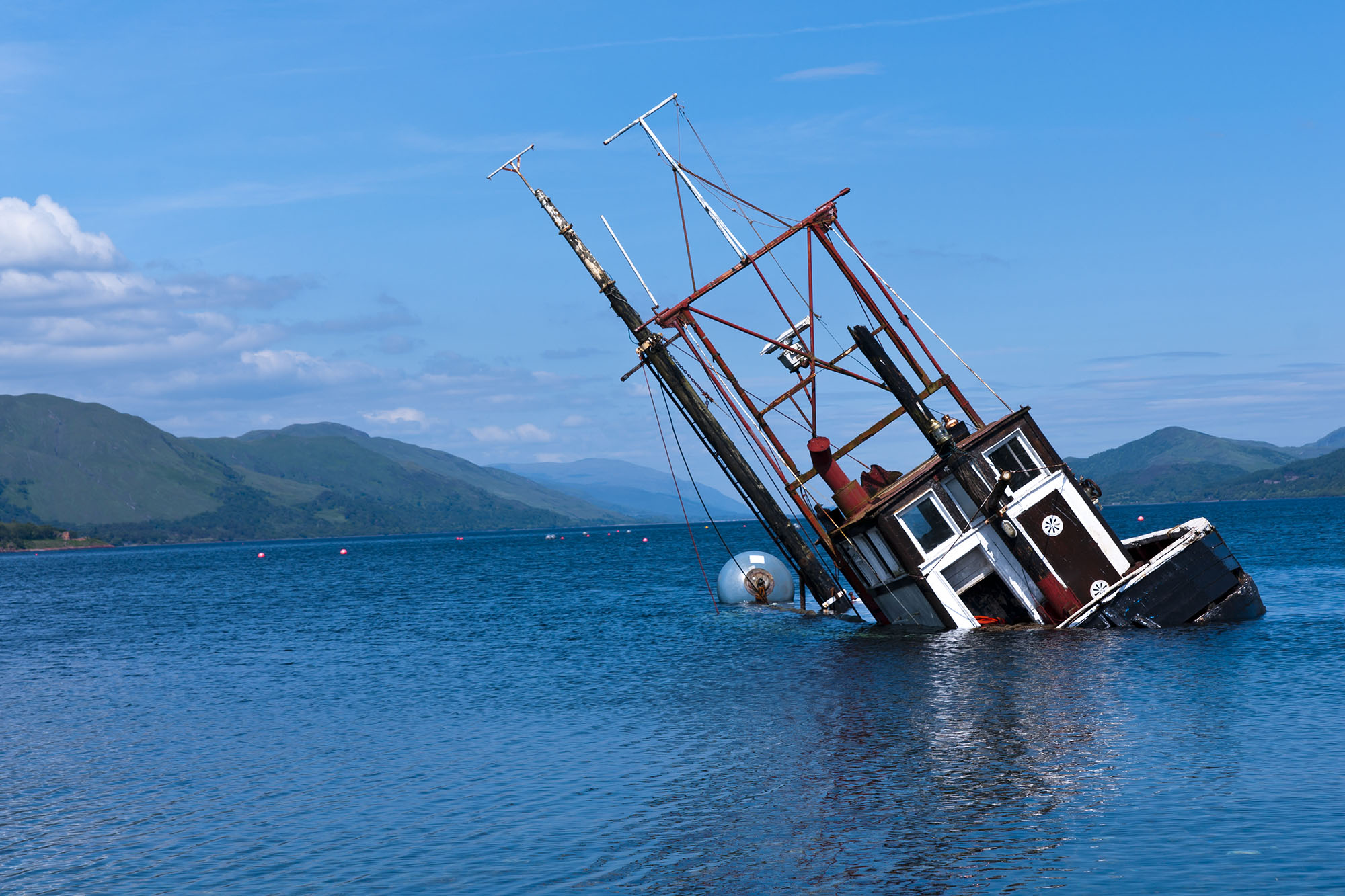 capsized boat accidental death drowning at work solicitors Aberdeen