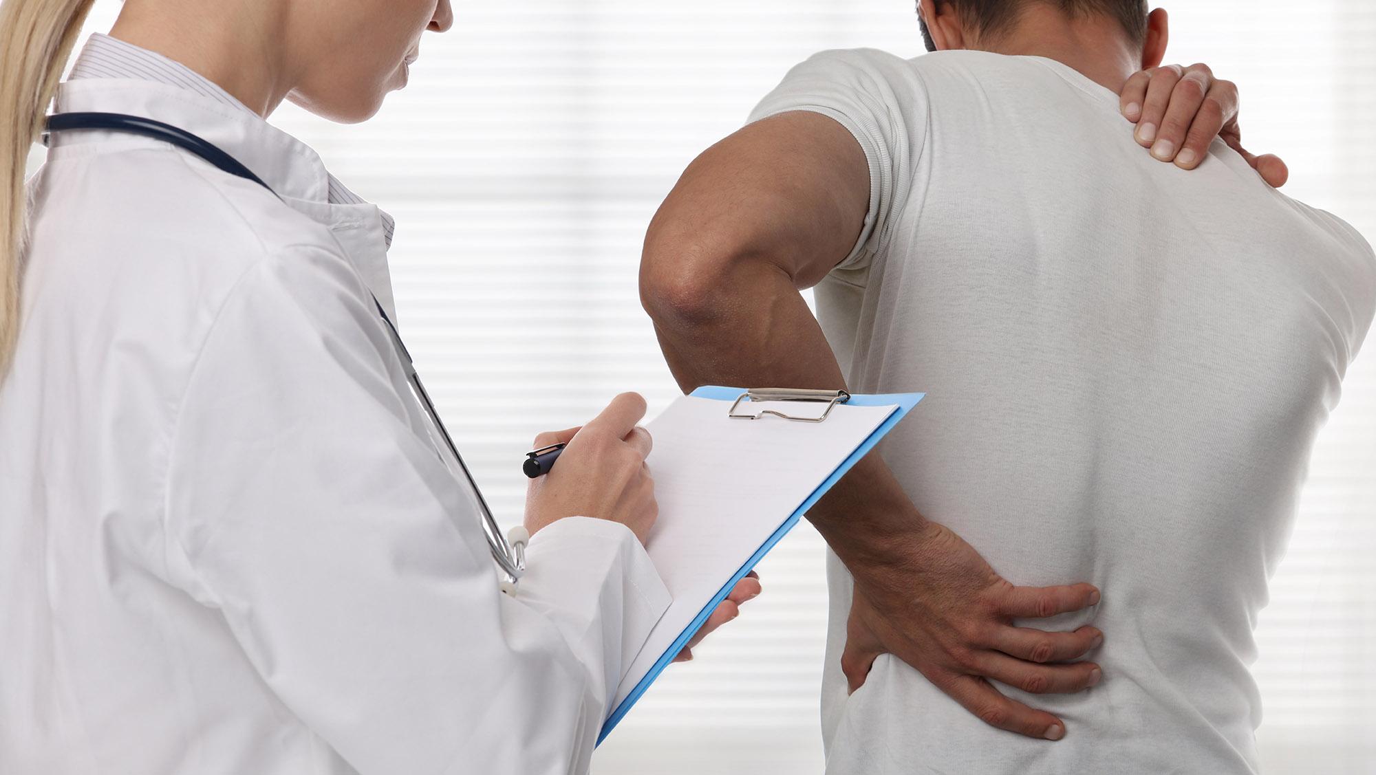 injured spine, back injury, doctor physio