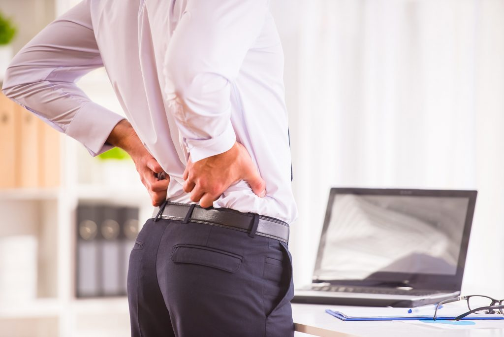 Back ache, spine pain from workplace, lack of time for breaks and exercise - RSI, joint pain, office worker